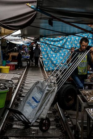 The railway track in Mae Klong market