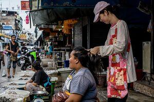 Woman doing customer's hair