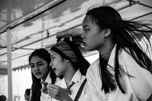 Three schoolgirls on passenger ferry
