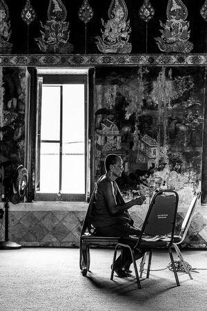 Buddhist monk reciting sutra