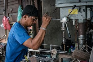 Man working with working machine