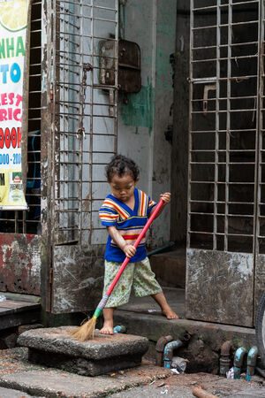 Little kid making a sweep