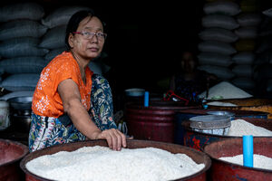 Woman and bowls filled with rice
