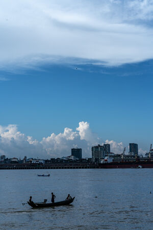 Fishing boat floating on Yangon river