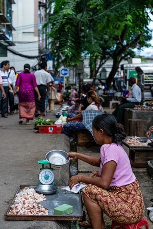 Woman selling shelled shrimps