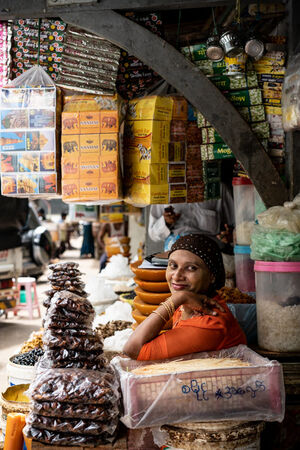 Woman surrounded by goods
