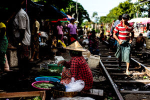 Woman doing business beside railway track
