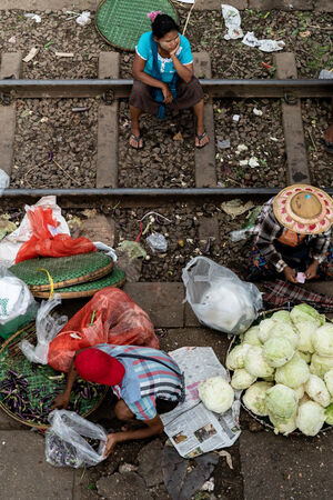 Eggplants and cabbages sold on platform