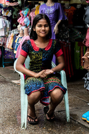 Girl wearing colorful dress