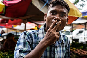 Man gazing while smoking cigarette