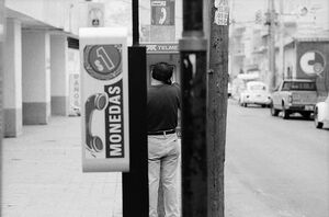 Man calling from pay phone