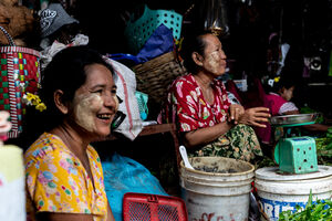 Smiling women in market