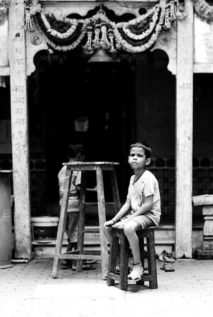 Boy sitting on chair