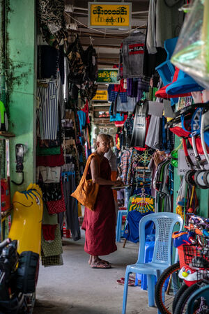 Buddhist monk standing in the corridor