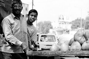 Father and son selling vegetables