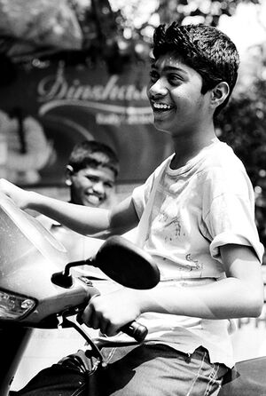 Young man smiling on motorbike