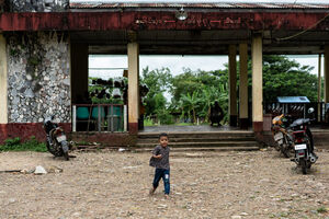 Boy walking alone in front of railway station