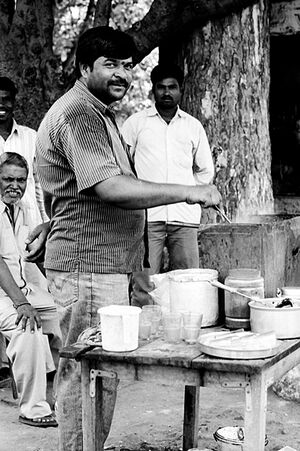 Man in chai stand