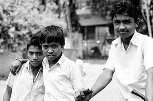 Three boys in street