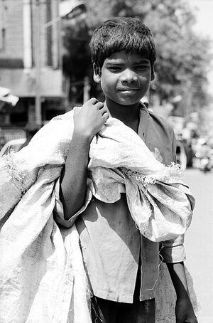 Boy carrying big bag