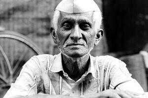 Old man wearing Gandhi cap