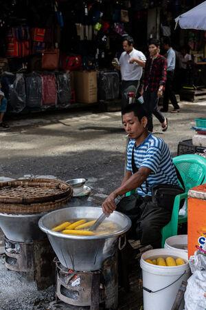 Man boiling corns