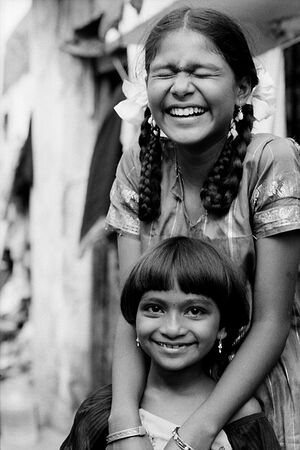 Girl with bobbed hair and girl with braid