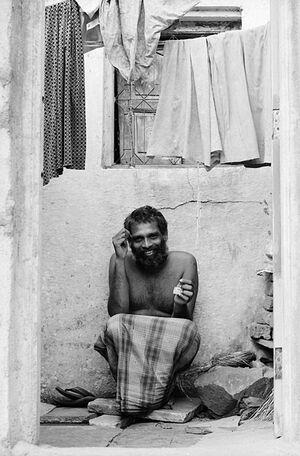 Man crouching inside