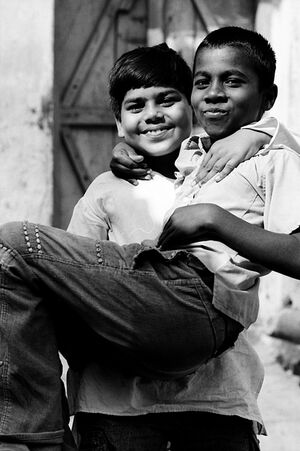 Boy holding friend