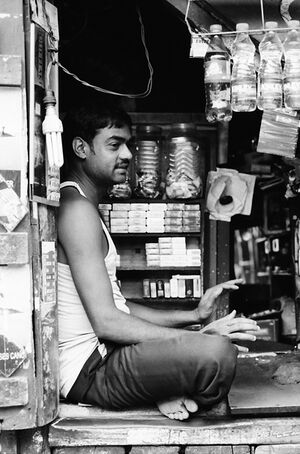 Man sitting in small shop