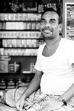 Tobacconist smiling