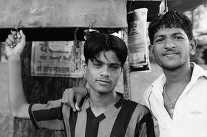 Two men in chai stand