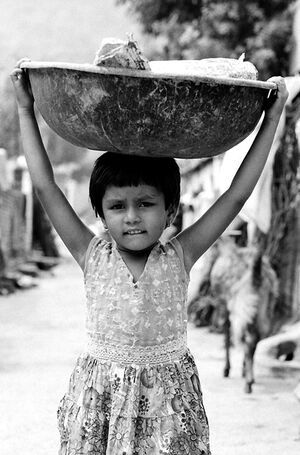 Girl carrying big bowl