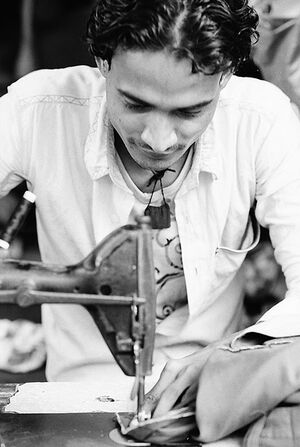 Young man sewing