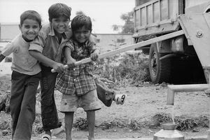 Boys collecting water together