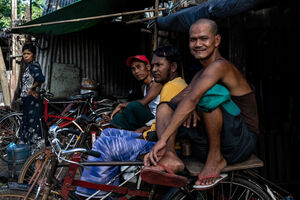 Pedicab drivers waiting for customers