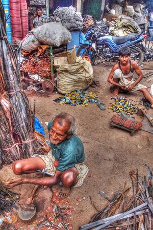 Men working among scrap iron