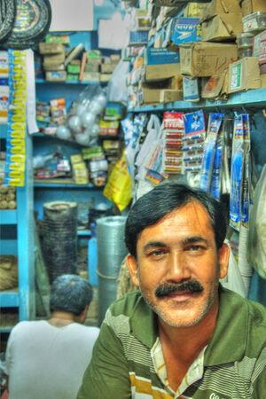 Calm man in small shop