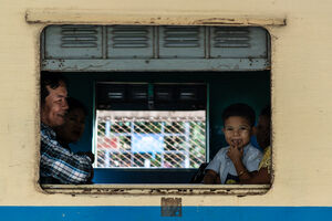 Family waiting for departure on train