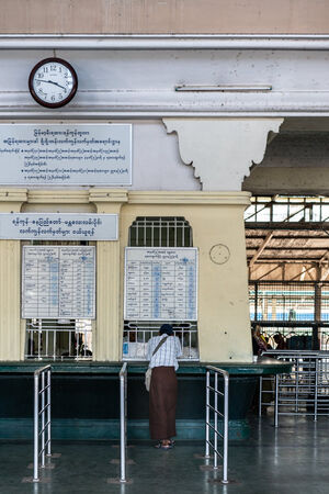 Man buying at ticket booth in Yangon Central Station