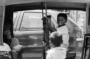 Kids on auto rickshaw