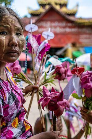 Flower seller working in Shwemawdaw Pagoda