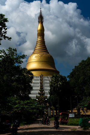 Golden Mahazedi Pagoda under blue sky