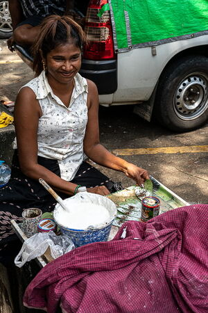 Woman selling Kun by roadside