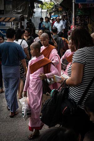 Buddhist nuns walking in crowds