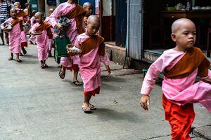 Little nuns walking sidewalk