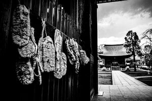 Straw sandals hung on wall in Buddhist temple