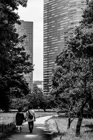 Couple walking hand in hand in Hamarikyu Gardens