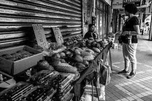 Fruit store on sidewalk