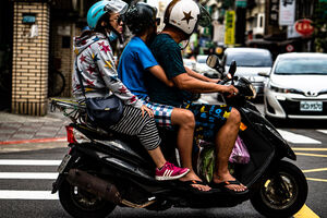 Family on the same motorbike